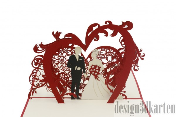 Hochzeitspaar unter dem Blumenbogen von design3dkarten